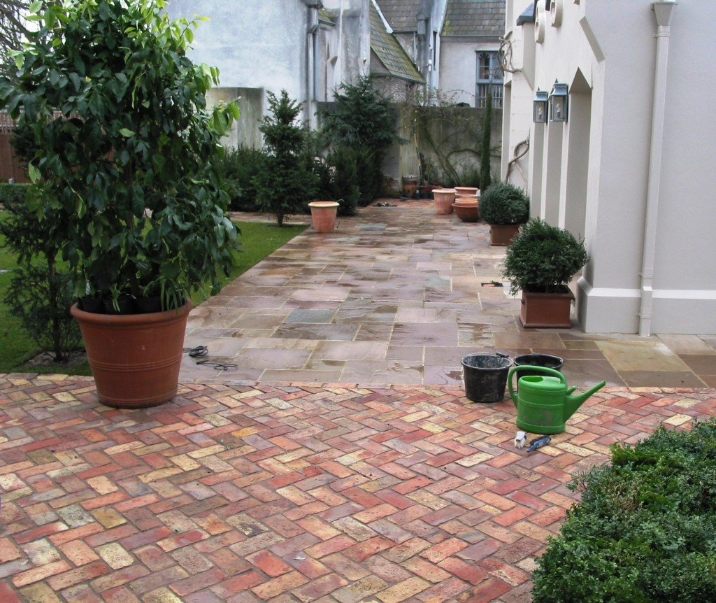 Garden with brick and indian sandstone paving simon for Landscaping bricks