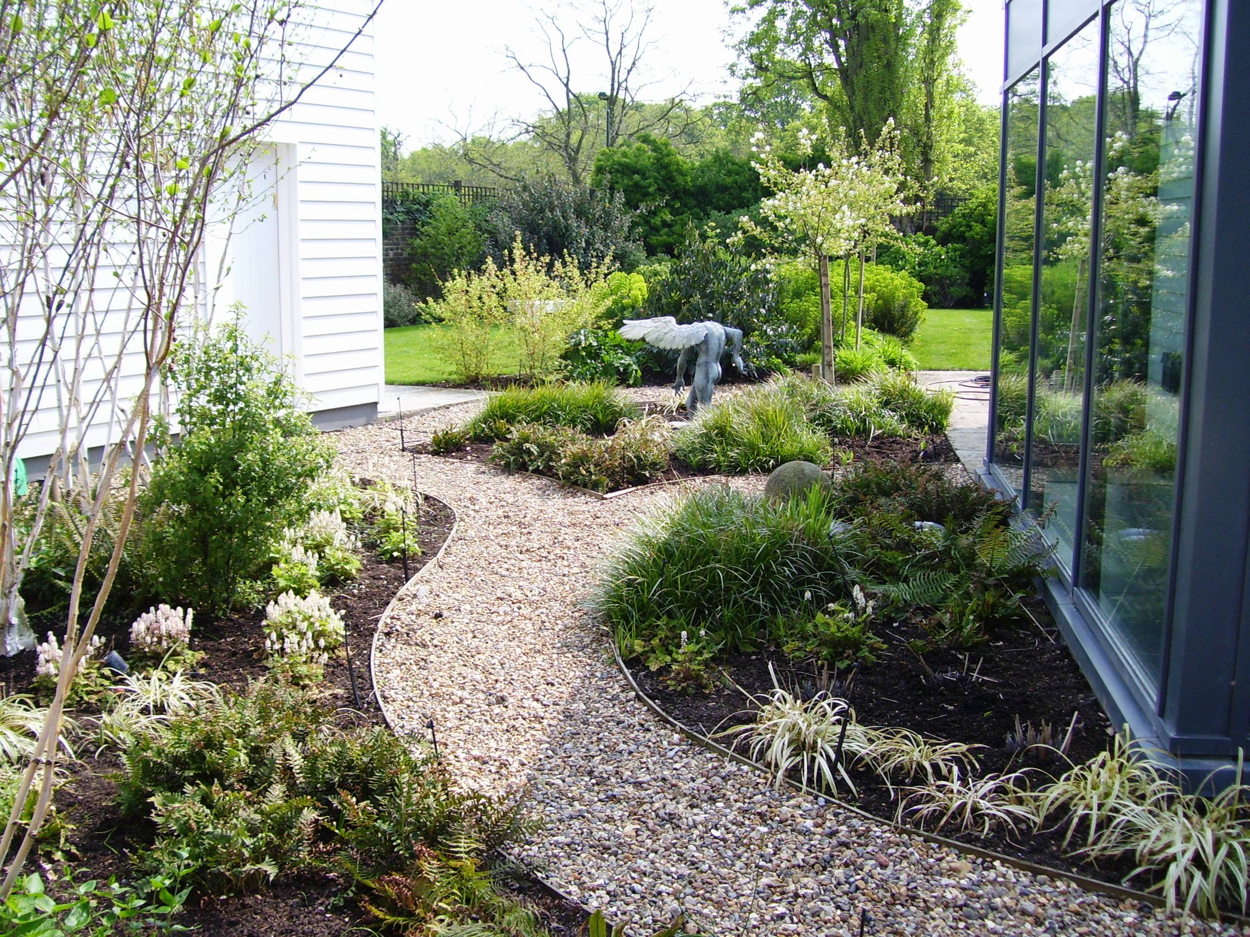 Garden with cobbled path and planting simon scott for How to landscape a garden