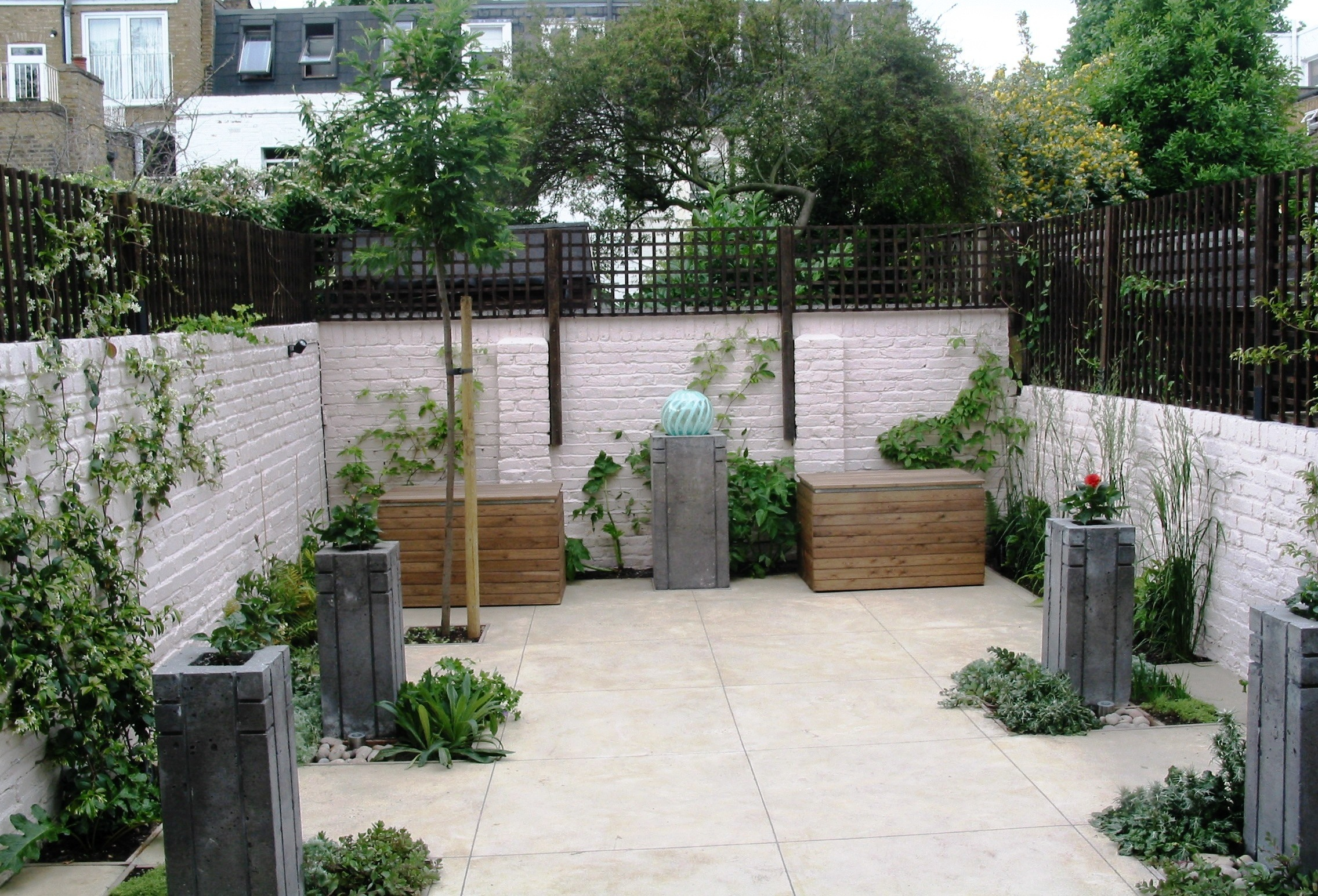 Garden With Concrete Planters, Water Feature And Polished Concrete Floor
