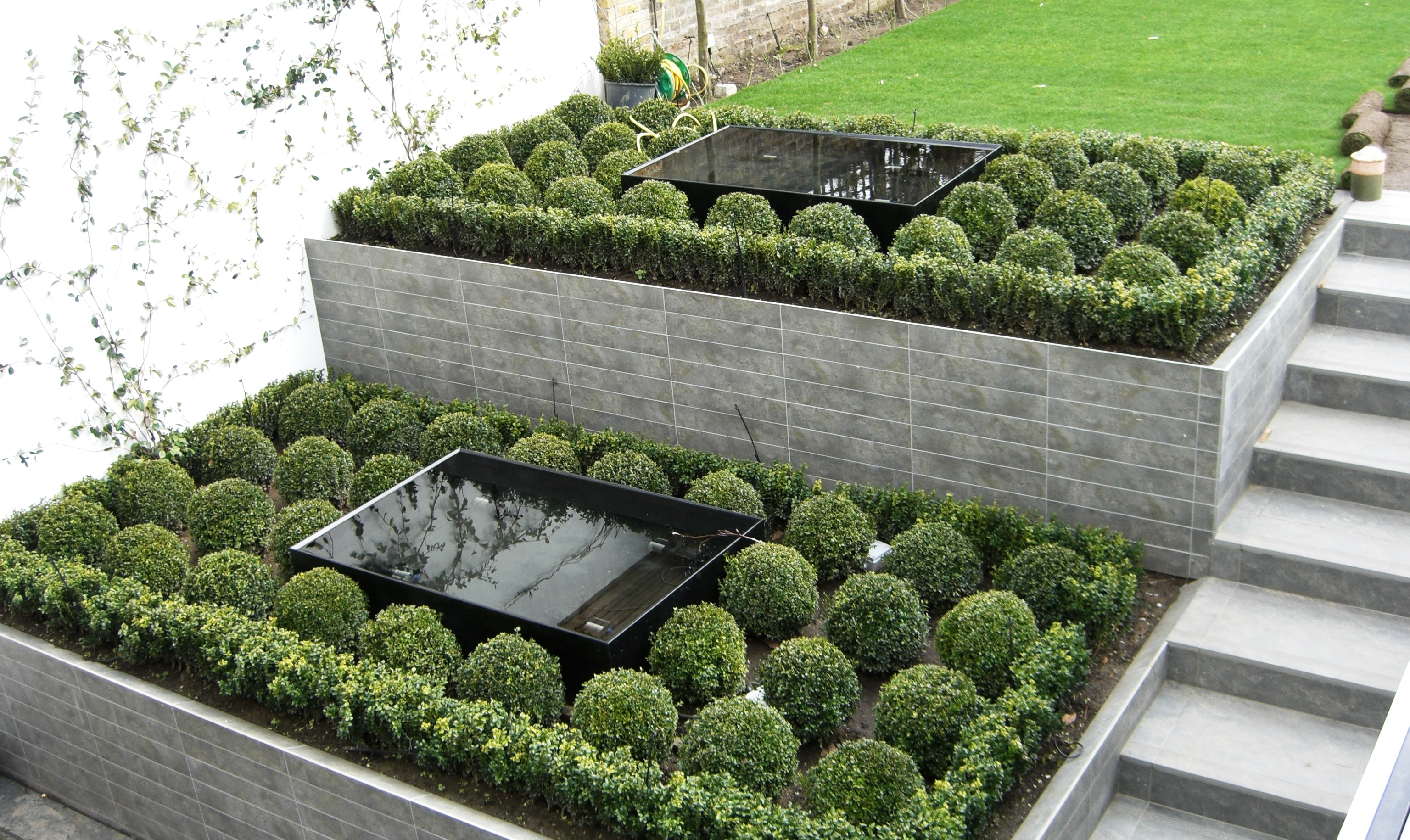 garden with lawn statue and planting garden with planting and slate ...