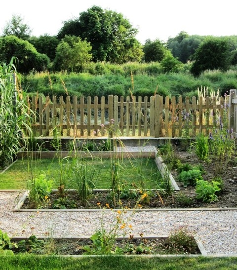 Riverside garden with paths lawn planting and gate for Garden design east sussex