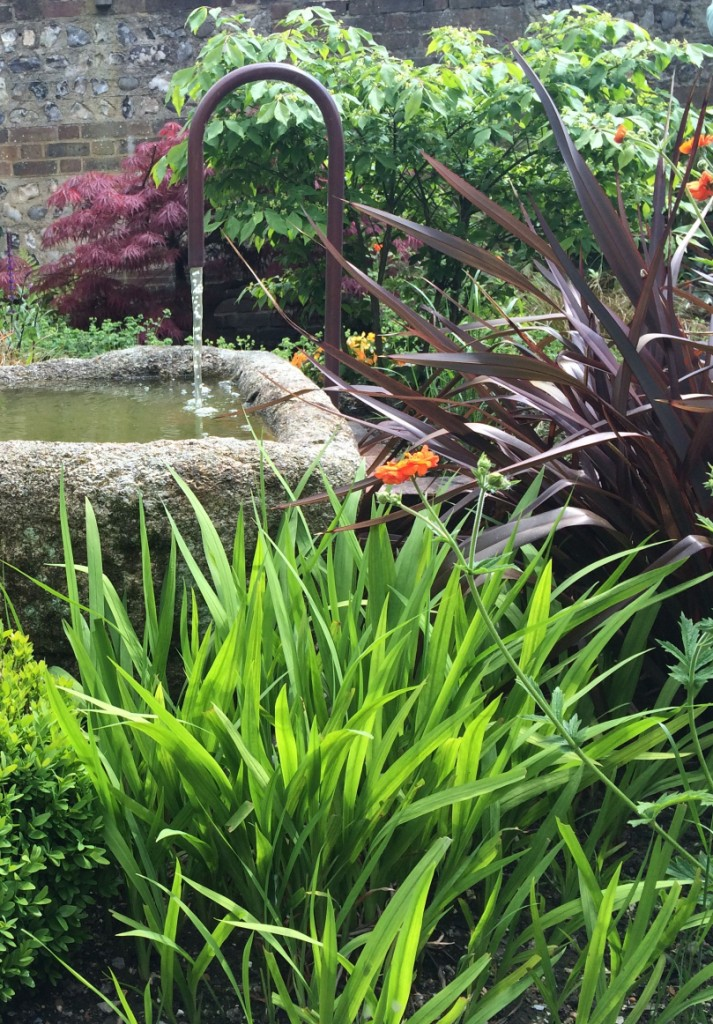 Courtyard garden with water trough feature and planting for Garden design east sussex
